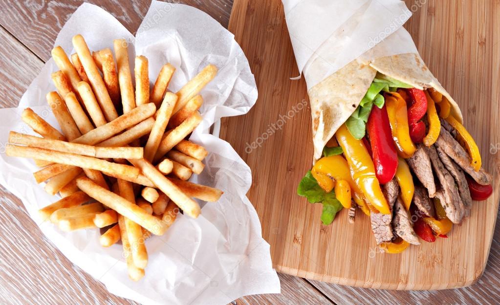 Fajitas with fries on board