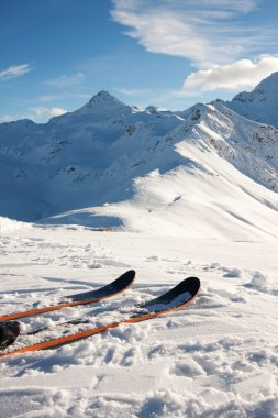 Skis in snow in mountains