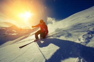 man skiing in powder snow