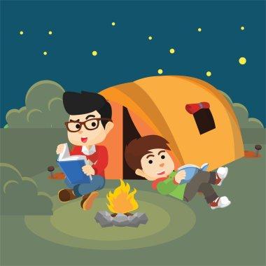 Boy reading book when Night camp