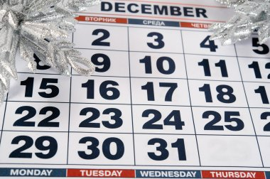 calendar for December with silver Christmas decorations