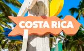 Photo Costa Rica signpost with palm trees