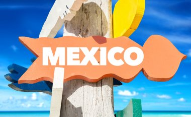 mexico signpost with beach