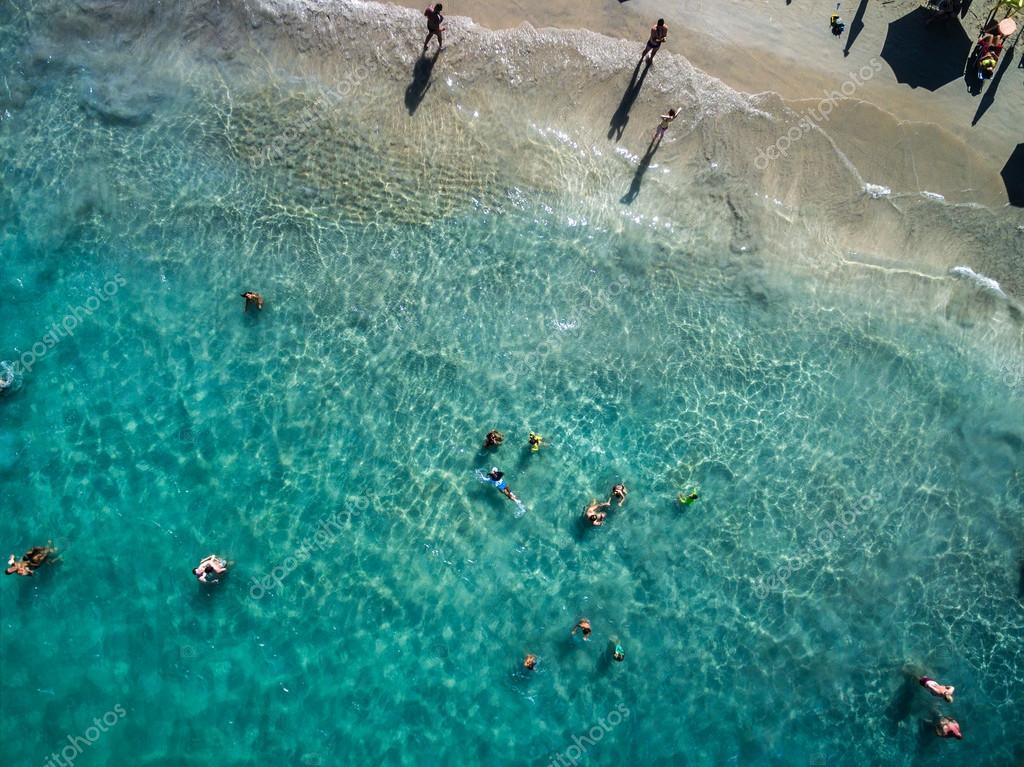 People Enjoying a Beach
