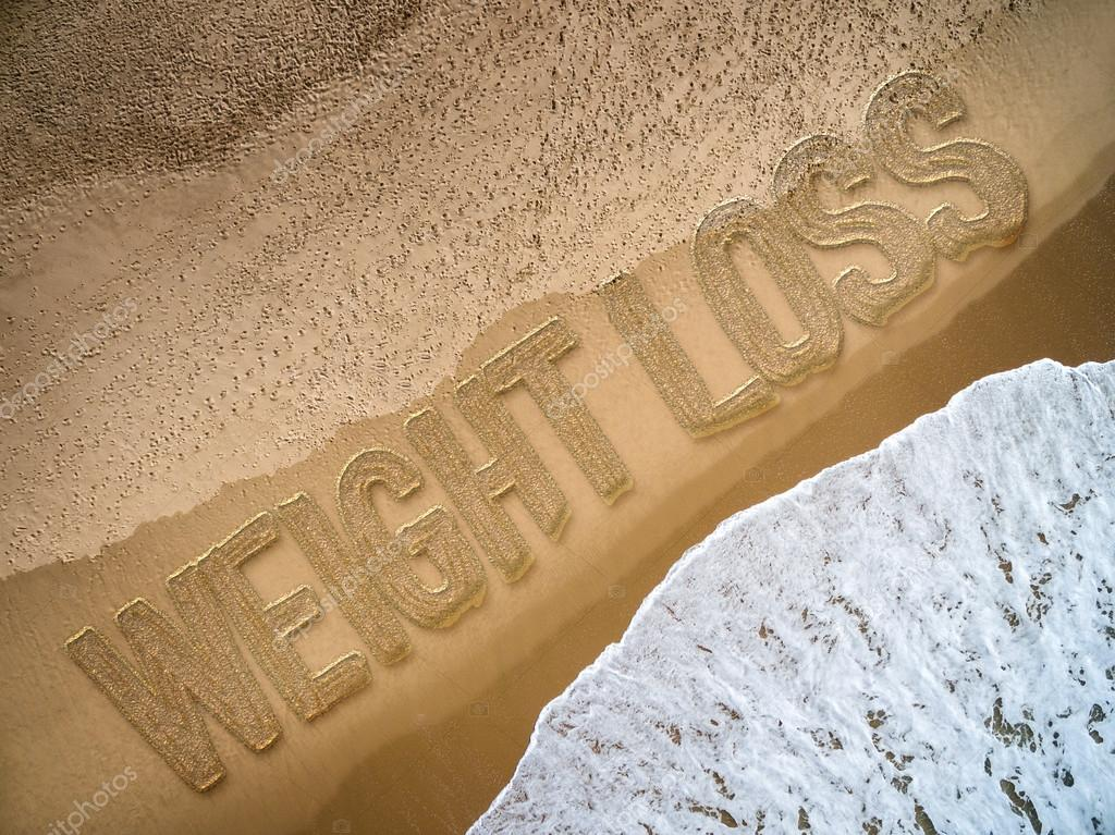 Weight Loss written on the beach
