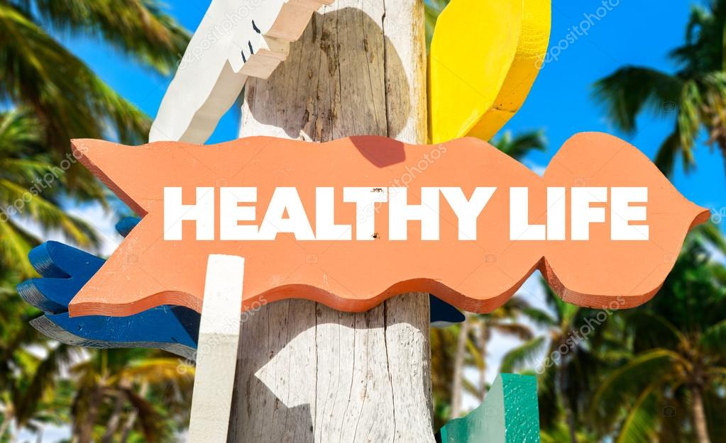 Healthy Life signpost with beach