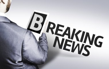 Business man with the text Breaking News in a concept image