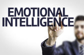 Photo Business man pointing to transparent board with text: Emotional Intelligence