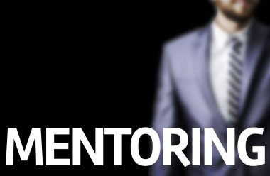 Mentoring written on a board with a business man