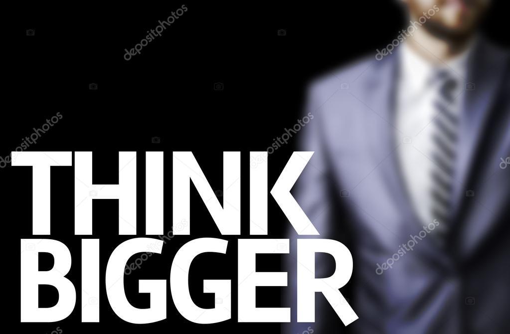 Matrimonio Con Uomo Più Grande : Pensate più grande scritta su una tavola con un uomo d