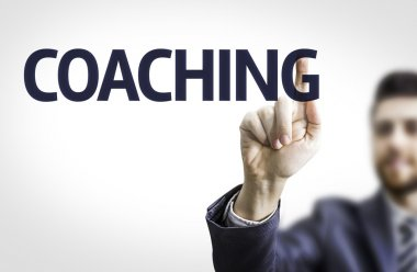 Business man pointing the text: Coaching