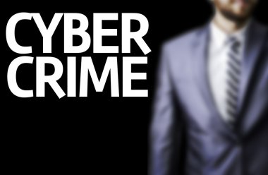 Cyber Crime written on a board with a business man