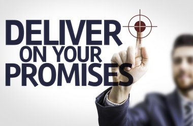 Business man pointing the text: Deliver on your Promises