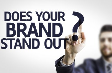 Business man pointing the text: Does your Brand Stand Out?