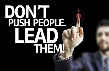 Business man pointing the text: Don't Push People, Lead Them!