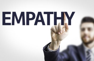 Business man pointing the text: Empathy