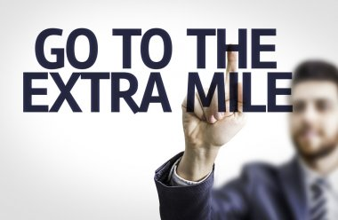 Board with text: Go To Extra Mile