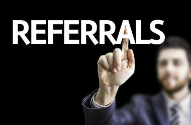 Business man pointing the text: Referrals