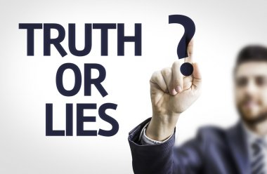 Business man pointing the text: Truth or Lies?