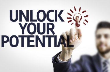 Business man pointing the text: Unlock Your Potential