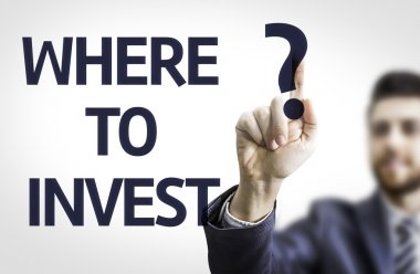 Business man pointing the text: Where to Invest?