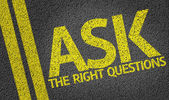 Fotografie Ask the Right Questions written on road