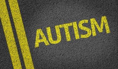Autism written on road