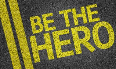 Be the Hero written on road