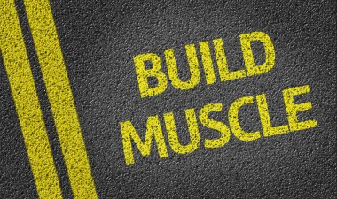 Build Muscle written on road