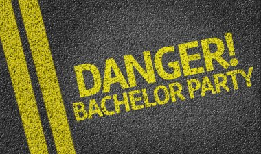 Danger! Bachelor Party written on road