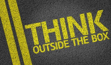 Think Outside the Box written on the road