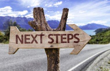 Next Steps wooden sign