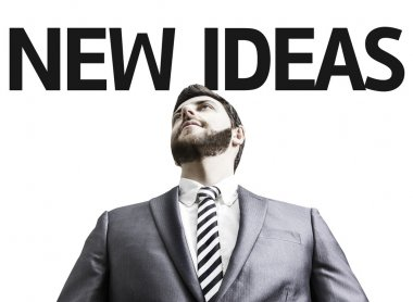 Business man with the text New Ideas in a concept image