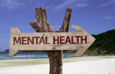 Mental Health wooden sign with a beach on background