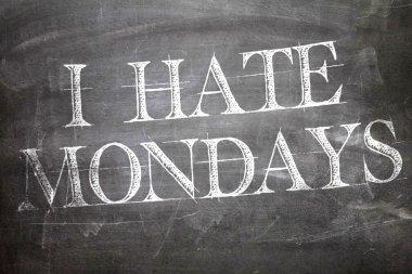 I Hate Mondays written on board