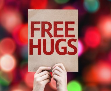 Free Hugs written on colorful background