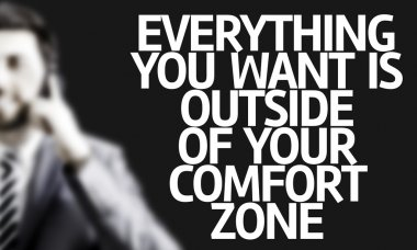 Business man with the text Everything You Want is Outside of Your Comfort Zone
