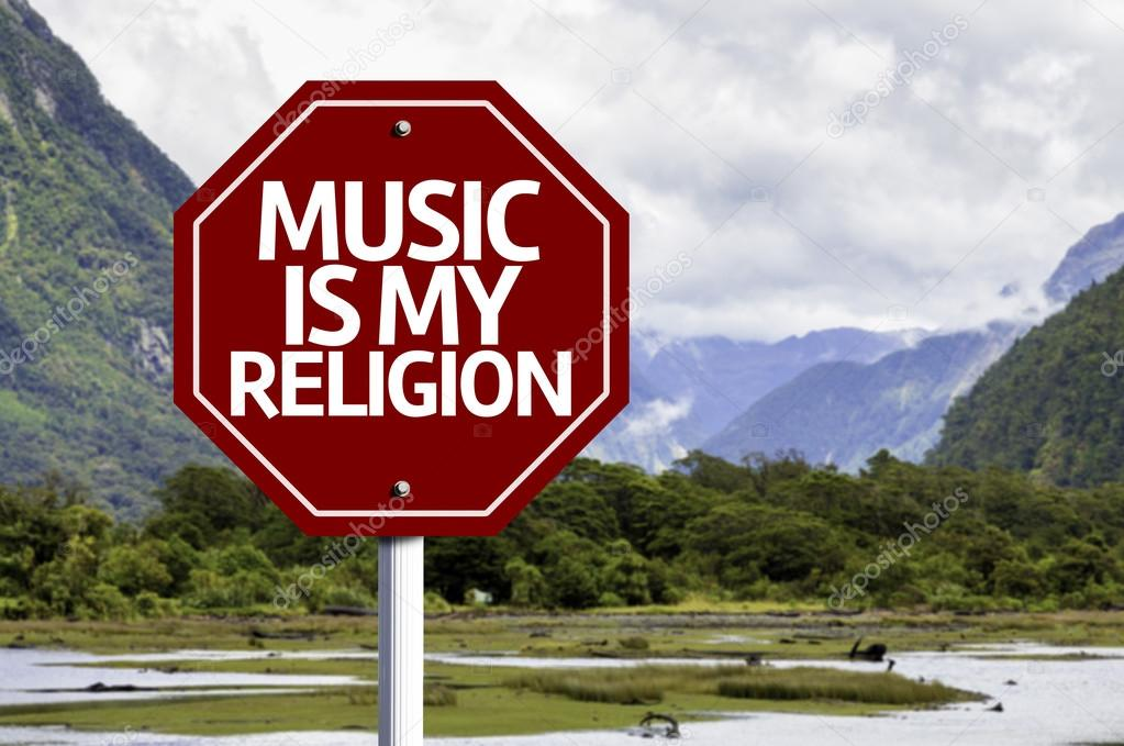 Music Is My Religion written on red road sign