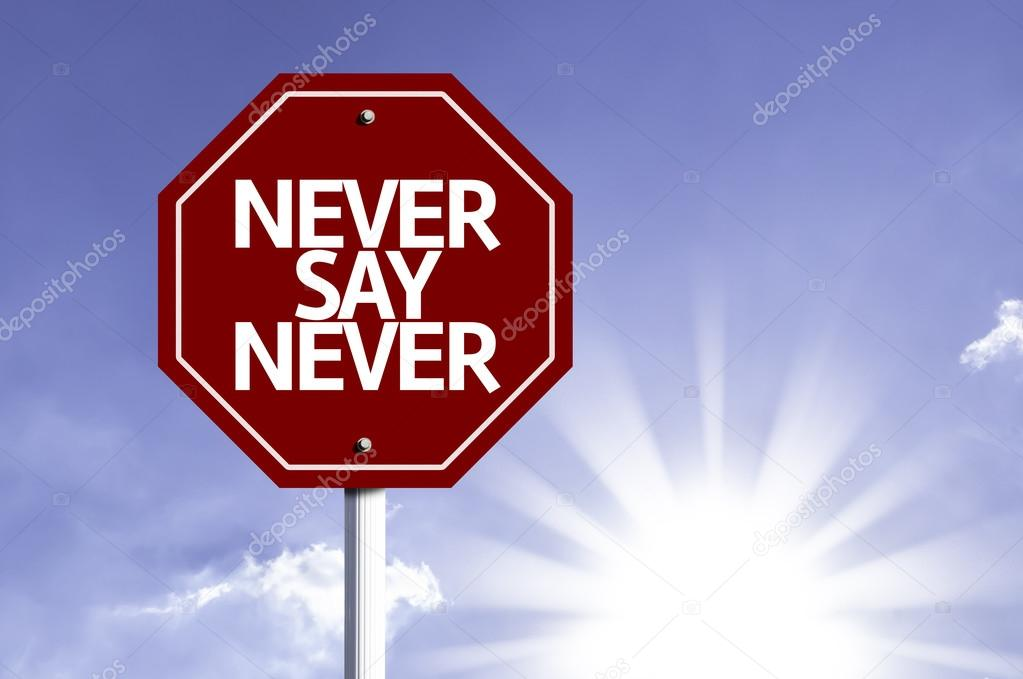 Never Say Never written on red road sign