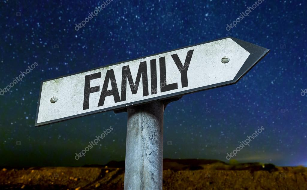 Family sign at night