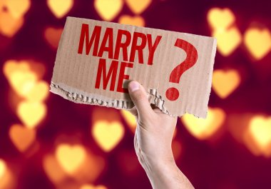 Marry Me? card in hand