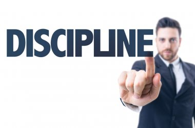Man with  text: Discipline