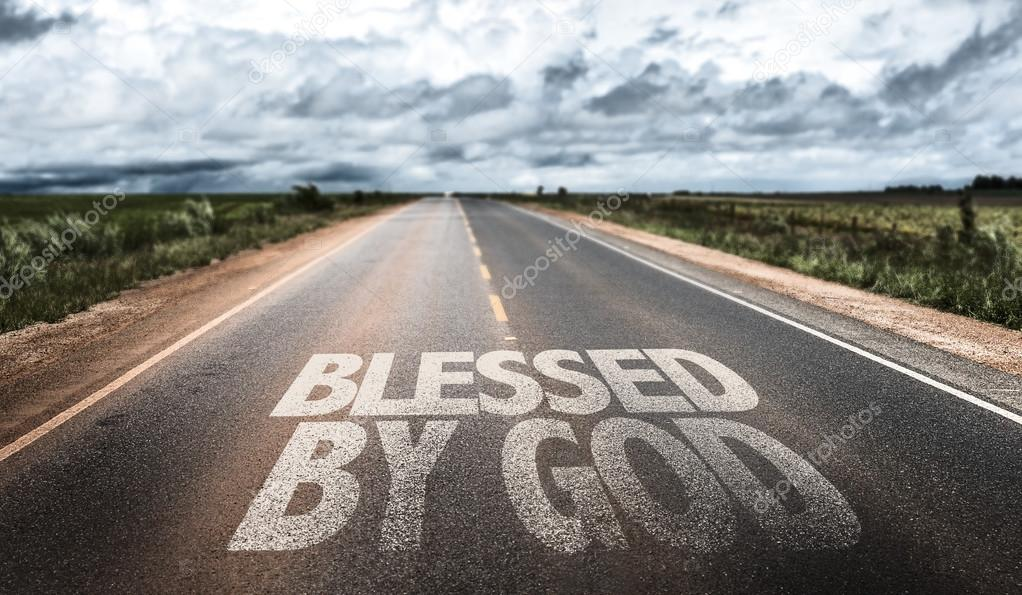 Blessed By God written on road