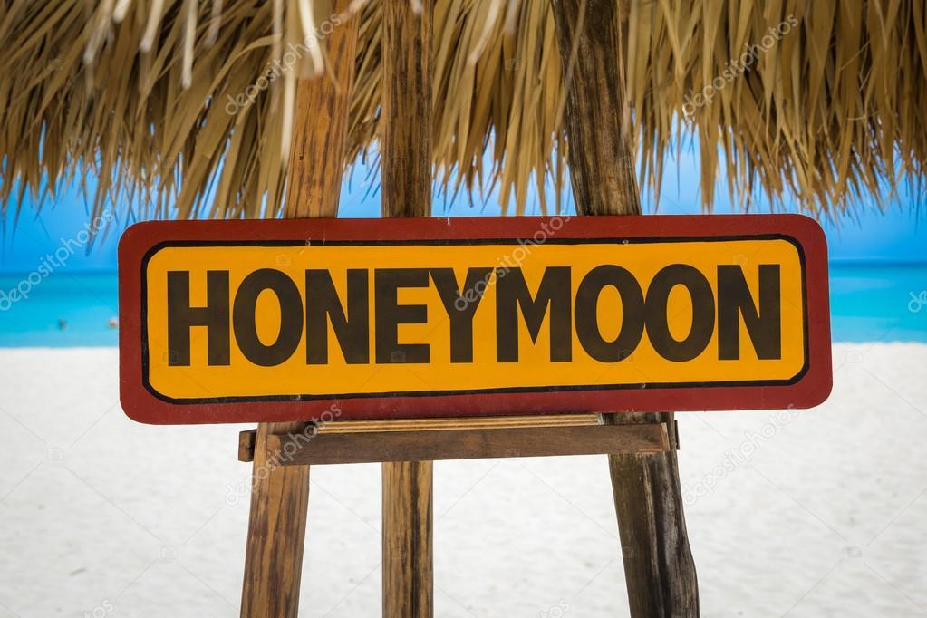 Honeymoon sign with beach