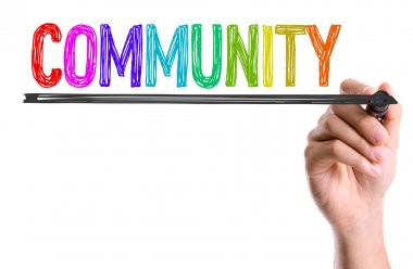 Hand writting the word community