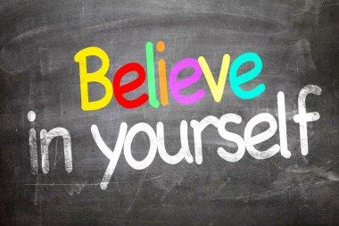 Believe in Yourself written on a chalkboard stock vector