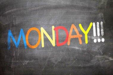 Monday written on a chalkboard