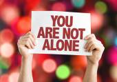 You Are Not Alone placard