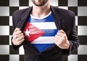 Businessman stretching suit with cuban flag