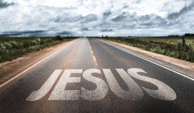 Jesus written on rural road stock vector